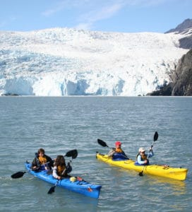 Sea Kayakers near a Glacier